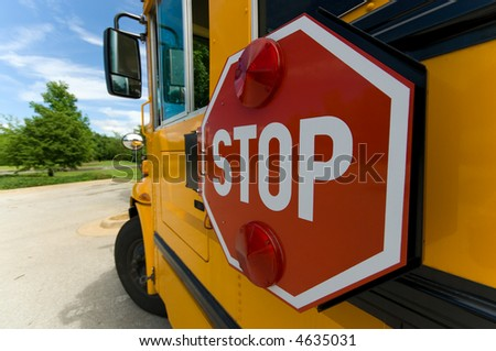 Wide angle view of school bus stop sign on sunny day