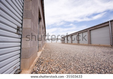 Wide angle view of storage units made of cinder blocks. - stock photo