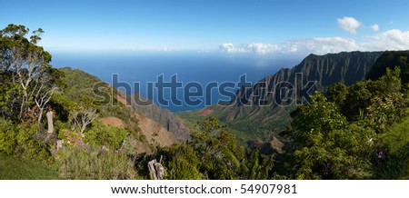 Wide angle view of the Kalalau Valley along the Na Pali Coast on the north shore of Kauai, Hawaii - stock photo