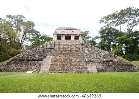 Wide angle view of the pyramid 'Temple of the Count' in the ancient Mayan city of Palenque. Chiapas, Mexico. - stock photo