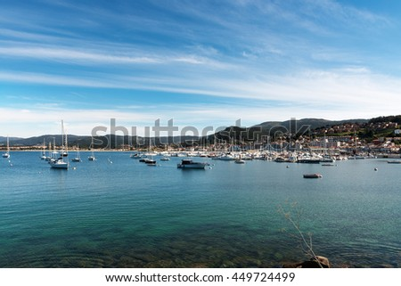 Wide-angle view of the sport port of Baiona full of small motor boats, Pontevedra, Spain.