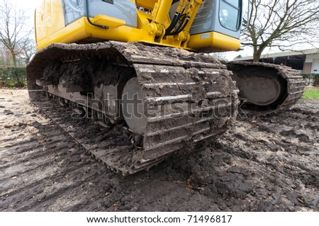 wide angle view of the tracks of an excavator - stock photo