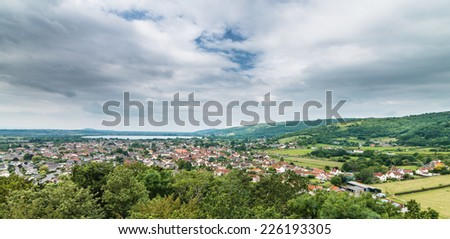 Wide angle view of the village of Cheddar with reservoir near Cheddar George, Somerset, UK - stock photo