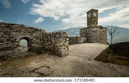Wide angle view on Clock tower and fortress in Gjirokastra, Albania - stock photo