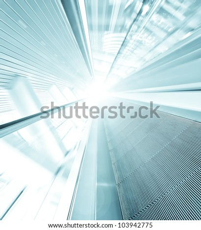 wide angle view to blue texture of contemporary escalator in business center - stock photo