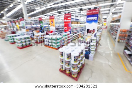 wide ankle view of home painting department at hardware store ,blur image.