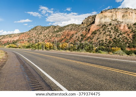 Wide asphalt mountain road in the sunny autumn somewhere in the USA