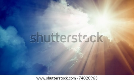 Wide background - bright sun with beams, dark clouds - stock photo