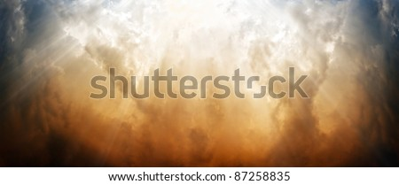Wide background - dramatic sky, bright sun light from above - stock photo