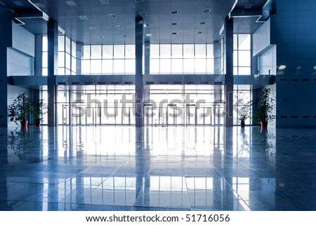 Wide blue hall interior - stock photo