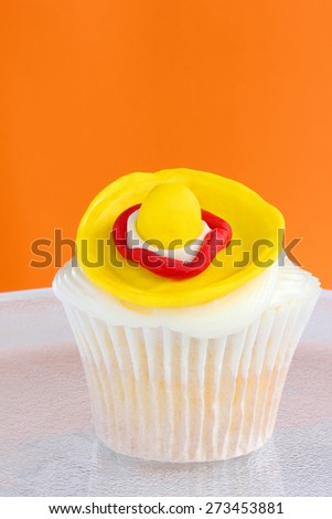 Wide-brimmed hat cupcake to celebrate the fifth of may - stock photo