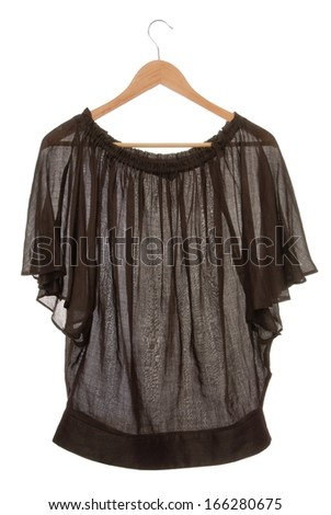 Wide brown blouse is on clothes-hanger.   - stock photo