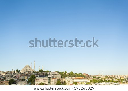 Wide cityscape view of Hagia Sofia mosque, other major mosques and city buildings over the Golden Horn, with plenty copy space. Istanbul, Turkey