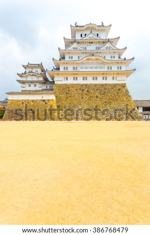 Wide dirt courtyard on the grounds inside the keep of Himeji-jo castle on a cloudy overcast day in Himeji, Japan after early 2015 renovations complete. Head on vertical