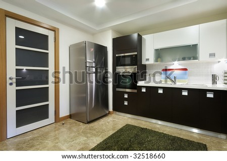 Wide Domestic Kitchen view with Door and refrigerator - stock photo