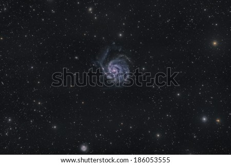 Wide Field View of M 101, a Spiral Galaxy in Ursa Major - stock photo