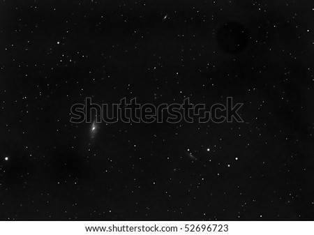 Wide field view of M106 and other galaxies - stock photo