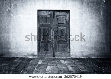 Wide grunge vintage background with old shabby door, empty room interior as backdrop