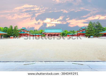 Wide inner courtyard with main Taikyokuden building centered of the Heian-Jingu shinto shrine during evening sunset in Kyoto, Japan