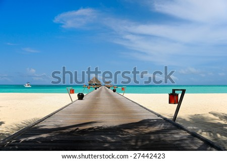 wide jetty over turquoise ocean - stock photo
