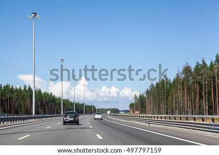 Wide multilane Ring Road in the forest at summer season, highway around the city, St. Petersburg, Russia