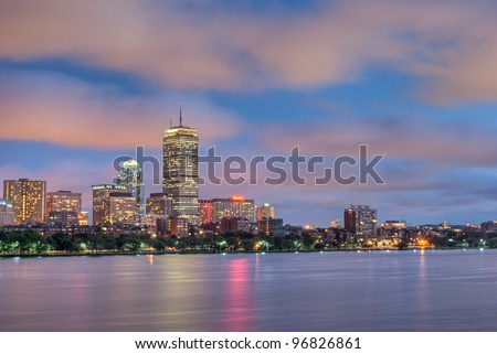 Wide Night view of the Boston Skyline with brightly illuminated buildings - stock photo