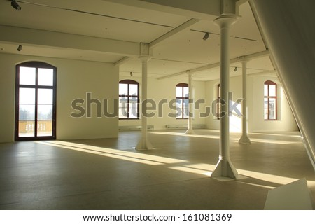 Wide open space, beams, columns and concrete floor - stock photo