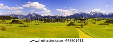 wide panorama landscape in Bavaria with alps mountains