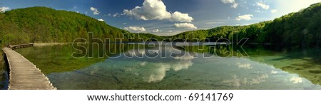 Wide panorama landscape of clear mountain lake in green forest in Plitvice Lakes national park, Croatia. UNESCO's World Heritage - stock photo