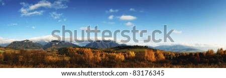 Wide panorama of country in autumn sunny day - stock photo