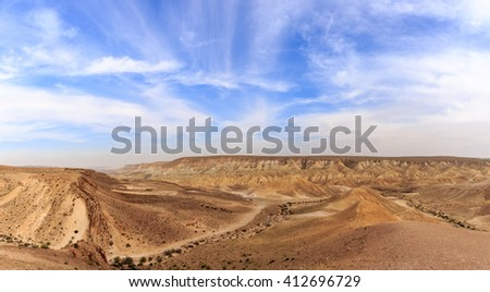 Wide panorama of mountains in Negev desert in Israel - stock photo