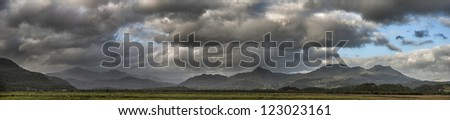 Wide panorama of Snowdonia National Park mountain range landscape