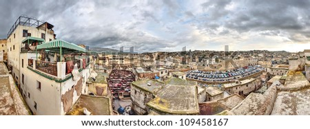 Wide panoramic view of the leather tannery in Fez, Morocco. Balcony above the shop allows observation of the Berbers working in coloring animal skins. Popular tourist place.