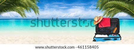 wide paradise beach panorama background with packed suitcase and coco palms