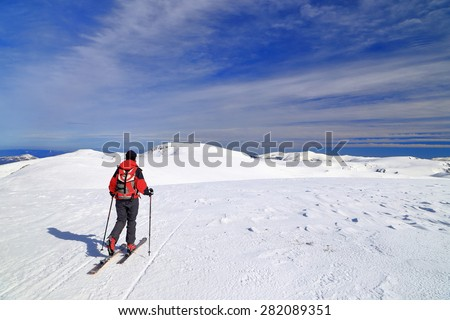 Wide plateau in front of a sky mountaineer in sunny day of winter - stock photo