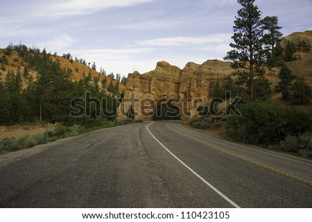 Wide road way turning to the left. - stock photo