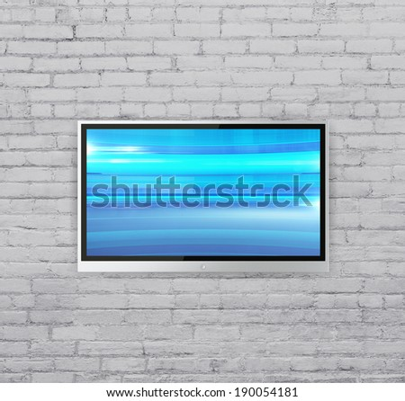 wide screen TV on brick wall  with Abstract blue cubes - stock photo