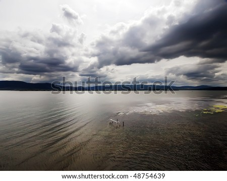 wide shoot of stormy sky over river Danube - stock photo