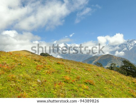 wide shot of mountain scene with high altitude meadows