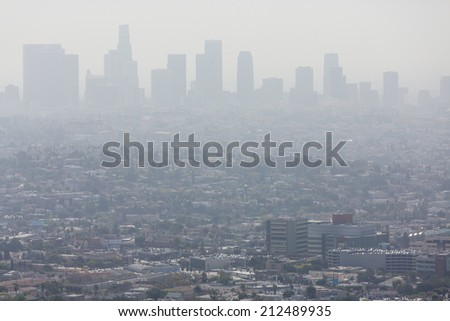 Wide shot of the downtown Los Angeles skyline bathed in smog. View from Griffith Park - stock photo