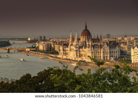Wide shot of the River Danube and Hungarian parliament seen from Buda Castle. Many boats on river. Taken at dusk