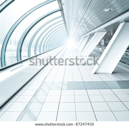 wide spacious corridor in contemporary airport walkway - stock photo