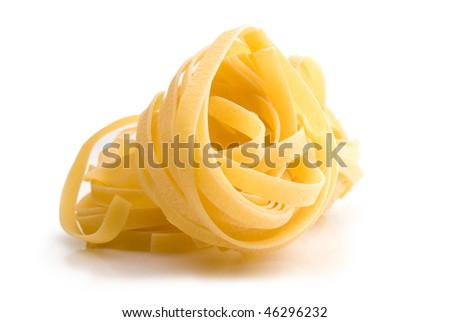 wide spaghetti isolated on white - stock photo