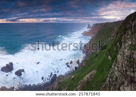 Wide sunset shot of a Cabo da Roca shore in Portugal. Most western part of Europe. - stock photo