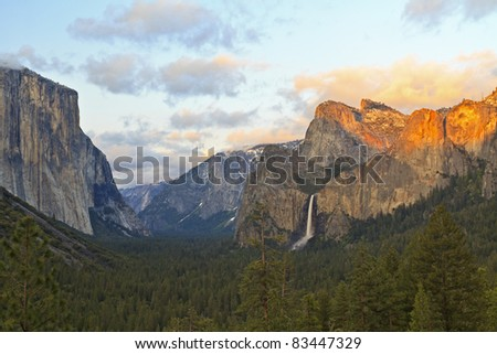 Wide sunset view of Yosemite Valley and Bridalveil Falls from Tunnel View in Yosemite National Park, California - stock photo