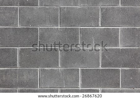 Wide view at modern wall made ouf of concrete blocks - stock photo