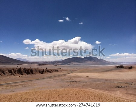 Wide view of Atacama desert and mountain - stock photo