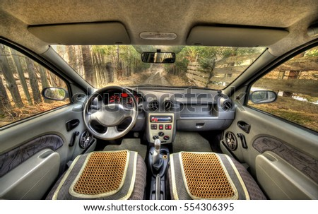 wide view of car interior in nature background