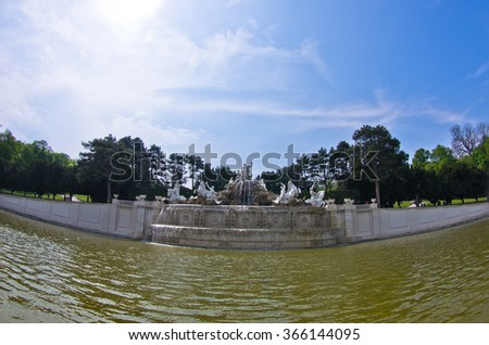 Wide view of Neptune fountain in front of Schenbrunn park and palace in Vienna, Austria - stock photo