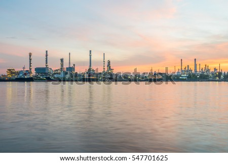 Wide view of riverside oil refinery factory on the horizon and the beautiful morning sky in Bangkok, Thailand